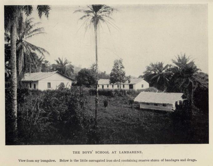 THE BOYS' SCHOOL AT LAMBARENE.  View from my bungalow.  Below is the little corrugated iron shed containing reserve stores of bandages and drugs.