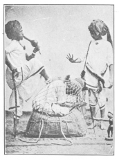 Position taken by the subject in the Indian basket trick before he is covered by the sheet.