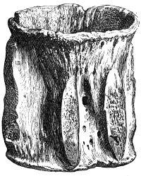 Fig. 209.—Cup made from Vertebra of Whale from Broch of Burray (4½ inches high).