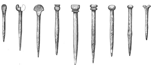 Fig. 225.—Bone Pins, with ornamental heads, from Broch of Burrian (actual size).