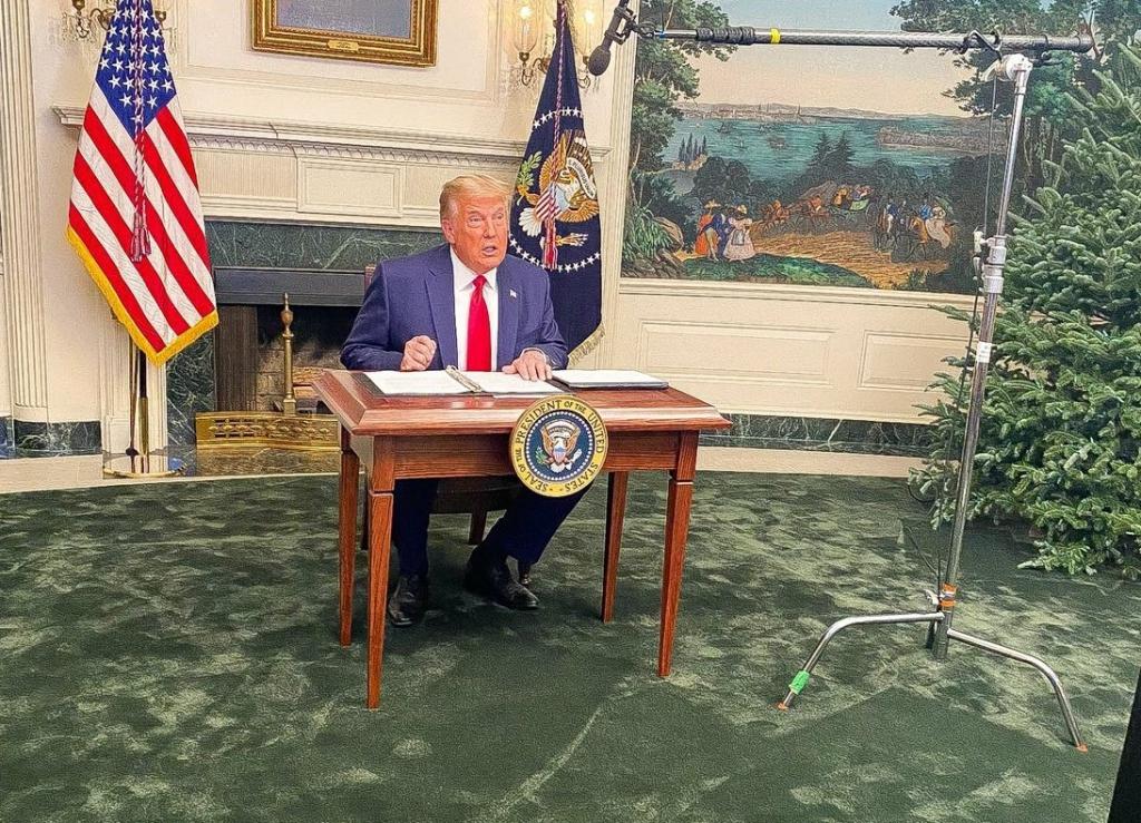Donald Trump Sitting At Signing Desk